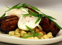 Fried hominy with char grilled andouille