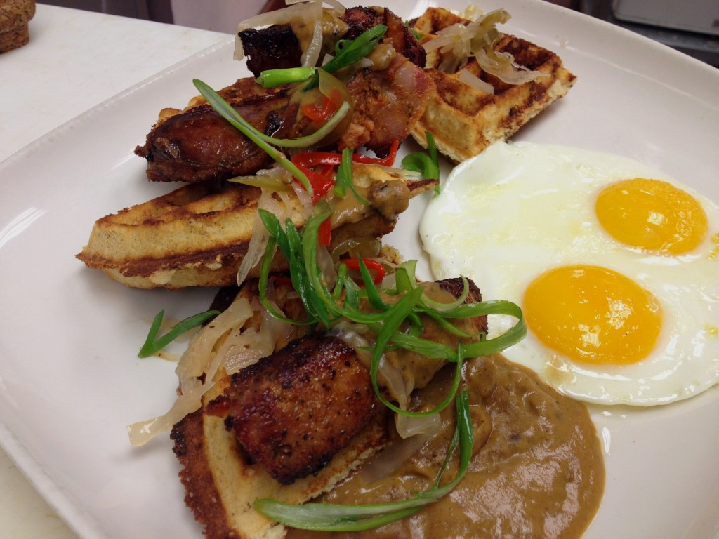 Colonial bennecake waffle with charred house andouille and sea island pea gravy