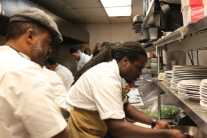 Chef Brian Jupiter on the plate up, with Chef Kristopher Murray